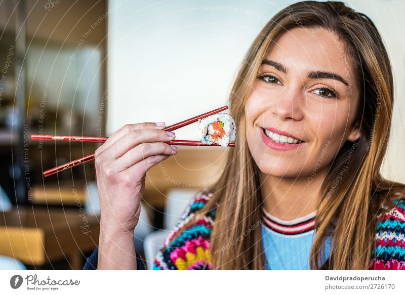 Woman eating sushi Japanese Attractive Beautiful Beauty Photography Blonde california roll Caucasian Chopstick Close-up Delicious Diet Dinner To feed Eating