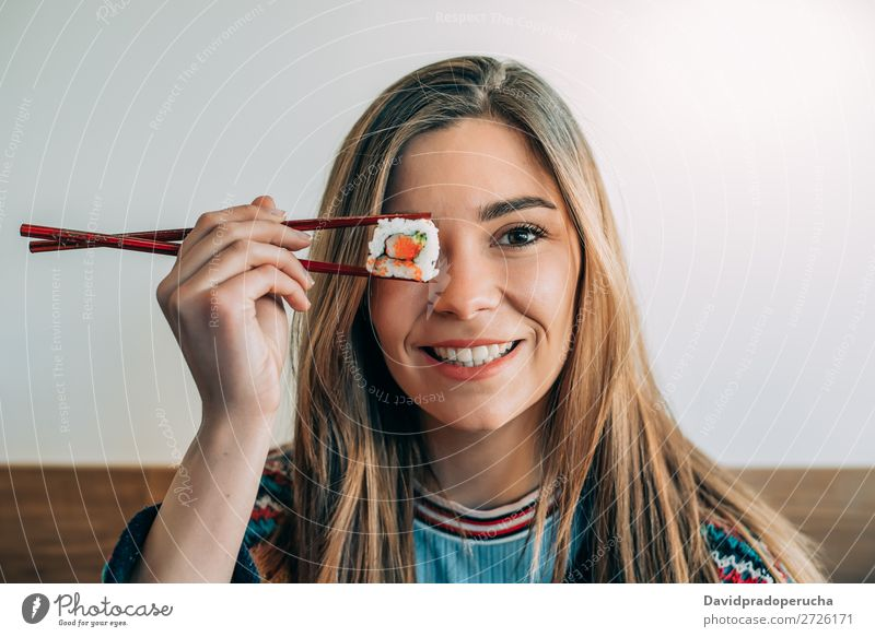 woman covering her eye with piece of sushi Sushi Woman Smiling Hand Food soy maki california roll Chopstick Roll Crops Unrecognizable Anonymous Close-up