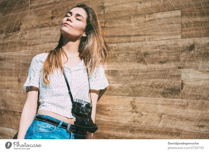 Beautiful woman with vintage old camera standing at a wood wall Vintage Camera Retro Woman Old Youth (Young adults) reel Portrait photograph Photography