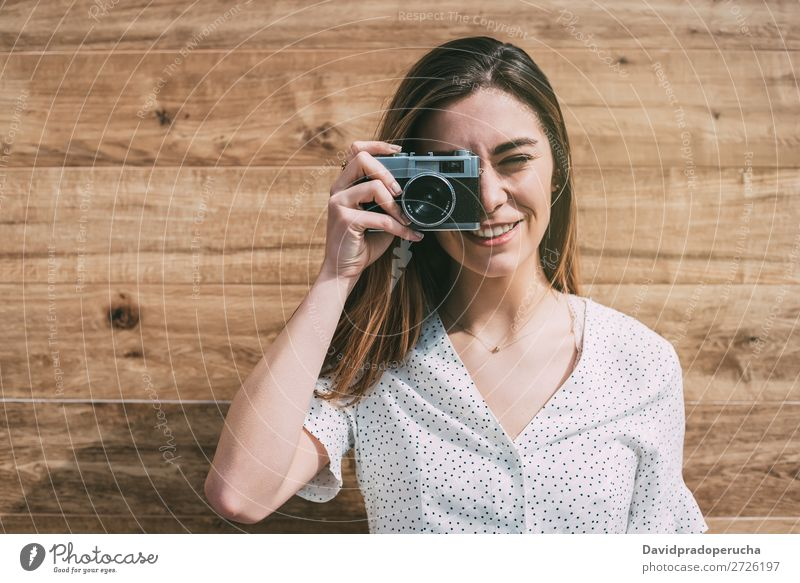 Beautiful woman with vintage old camera taking photo Vintage Camera Retro Woman Old Youth (Young adults) Take Shot looking to the camera reel