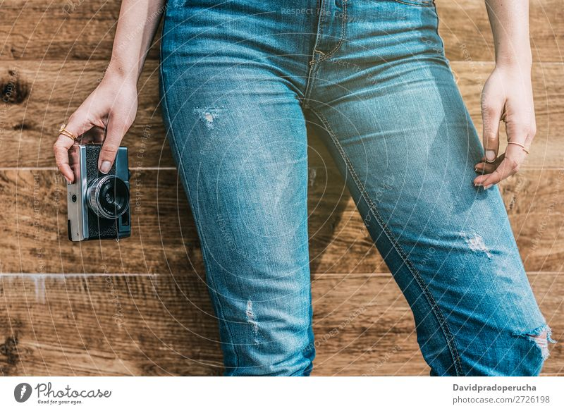 Cropped woman jeans legs with vintage old camera Vintage Camera Retro Woman Legs Old Youth (Young adults) Partially visible reel Anonymous Unrecognizable