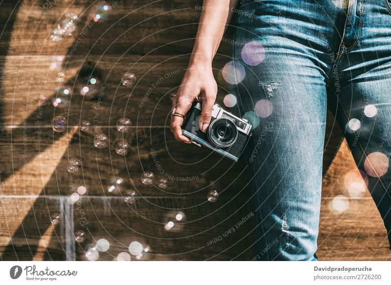 Cropped woman jeans legs with vintage old camera and bubbles Vintage Camera Retro Woman Legs Air bubble Old Youth (Young adults) Partially visible reel