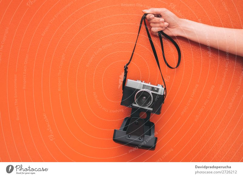 Hand holding a Vintage camera isolated at orange wall Arm Camera Wall (building) Orange Retro Old Isolated Studio shot Hold Leisure and hobbies Illustration