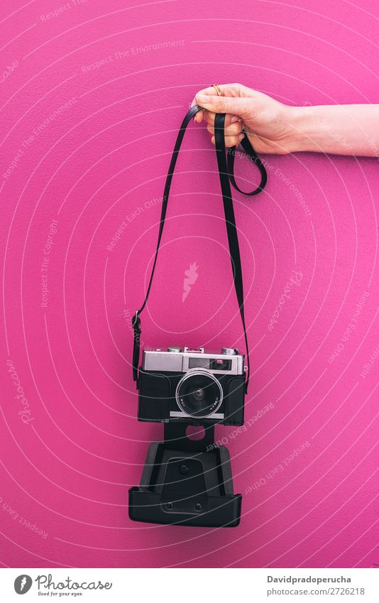 Hand holding a Vintage camera isolated at pink wall Arm Camera Pink Wall (building) Retro Old Isolated Studio shot Hold Leisure and hobbies Illustration Blank