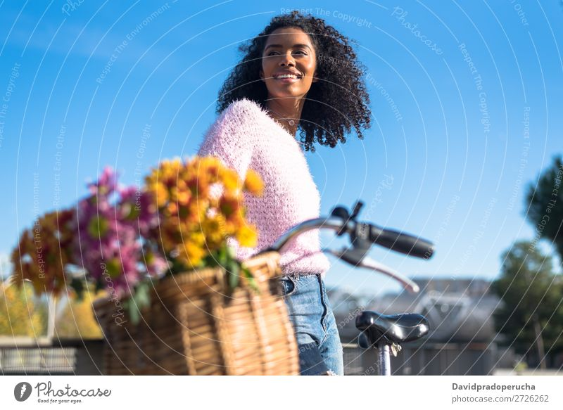 Black young woman riding a vintage bicycle Bicycle Girl Woman Vintage Ride Beautiful Retro Flower Sunbeam Happy Bouquet Summer Youth (Young adults) pretty