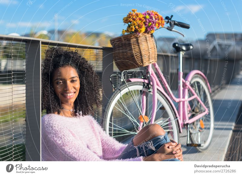 Black young woman sitting by the river with her vintage bicycle Bicycle Girl Beautiful Retro Flower Happy Vintage Bouquet Pink Summer Youth (Young adults) Woman