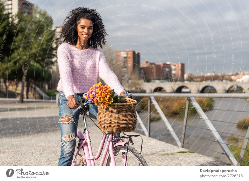 Black young woman riding a vintage bicycle Bicycle Girl Woman Vintage Ride Beautiful Retro Flower Happy Bouquet Summer Youth (Young adults) pretty Spring Basket