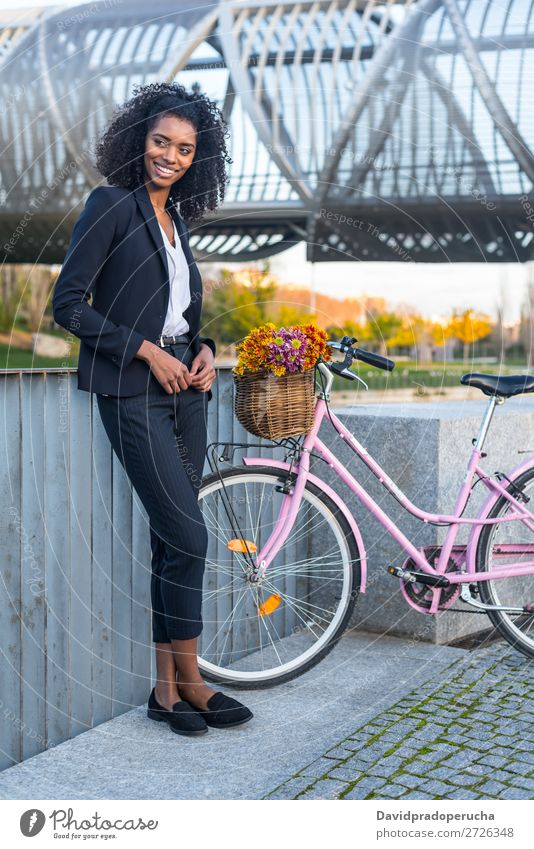 Business black woman with vintage bicycle Bicycle Cycling Vintage Woman Black Mixed race ethnicity City Youth (Young adults) Human being Suit Street Hair