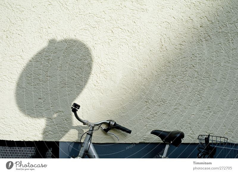 Karl in Monnem: Blues Mannheim Wall (barrier) Wall (building) Bicycle Concrete Metal Stand Firm Gray Black White Emotions Calm Shadow Lean Colour photo