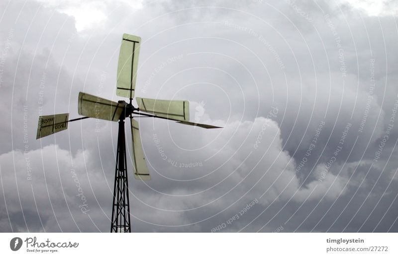 With the wind Water pump Clouds Dark Storm Gale Windmill Industry Wing