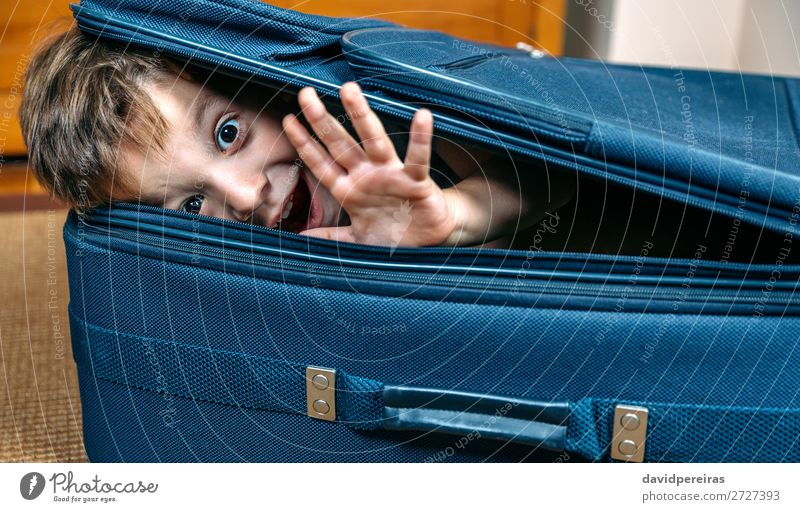 Funny boy smiling inside a suitcase Lifestyle Joy Happy Leisure and hobbies Vacation & Travel Trip Summer Child Human being Boy (child) Man Adults