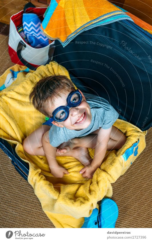 Funny boy smiling sitting inside a suitcase Lifestyle Joy Happy Swimming pool Leisure and hobbies Vacation & Travel Trip Summer Beach Child Human being