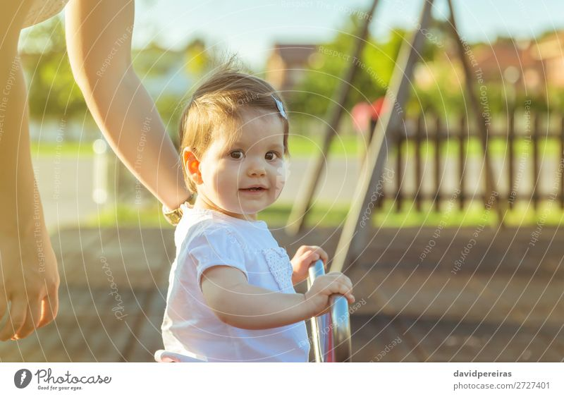 Baby girl playing over a seesaw swing on the park Lifestyle Joy Happy Beautiful Relaxation Leisure and hobbies Playing Freedom Summer Sun Child Toddler Woman