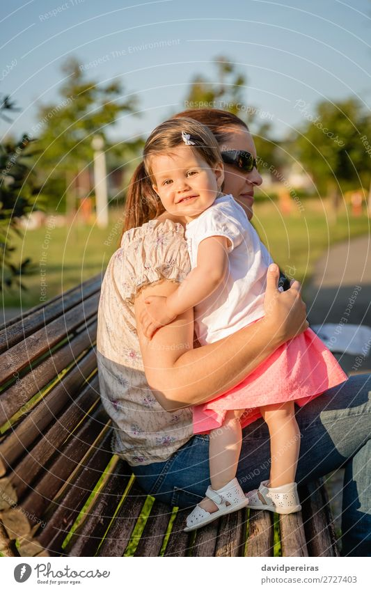 Baby girl standing on a bench hugging to woman Lifestyle Joy Beautiful Leisure and hobbies Summer Garden Child Human being Toddler Woman Adults Mother