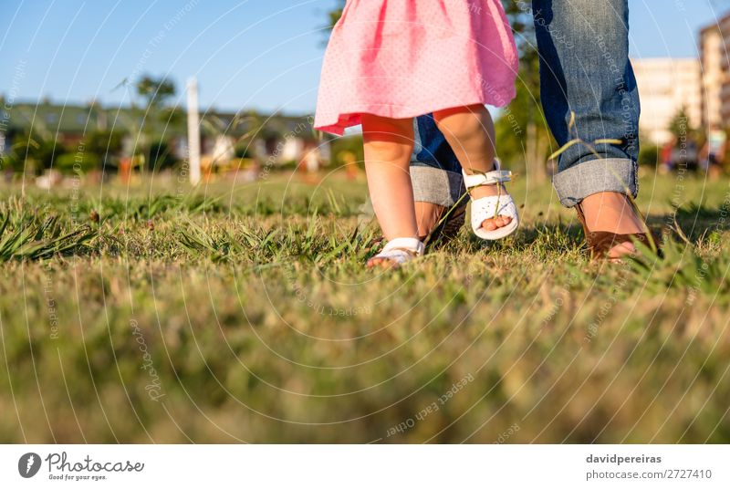 Baby girl learning to walk over a grass park Lifestyle Joy Happy Leisure and hobbies Summer Garden Human being Toddler Woman Adults Mother Family & Relations