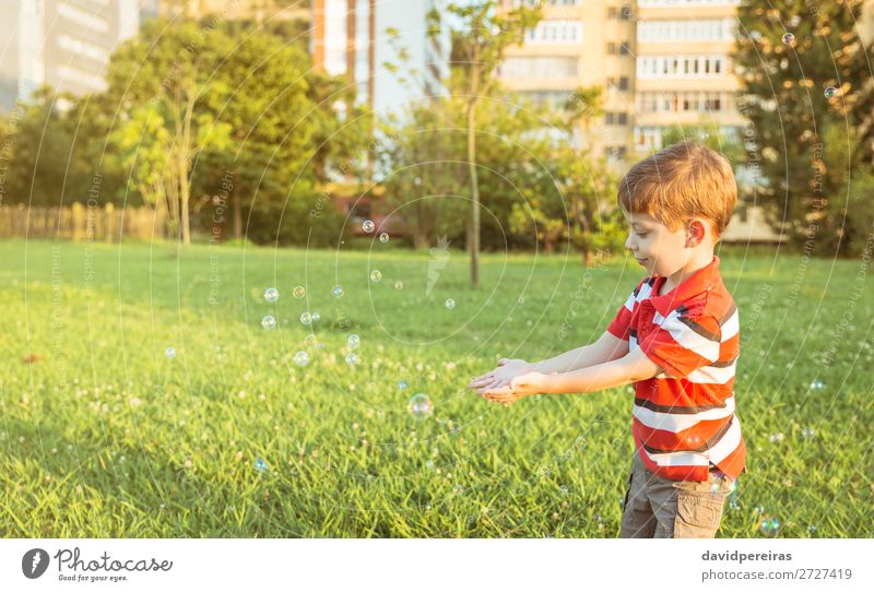 Happy boy playing with soap bubbles in the park Lifestyle Joy Beautiful Relaxation Leisure and hobbies Playing Freedom Summer Garden Child Human being