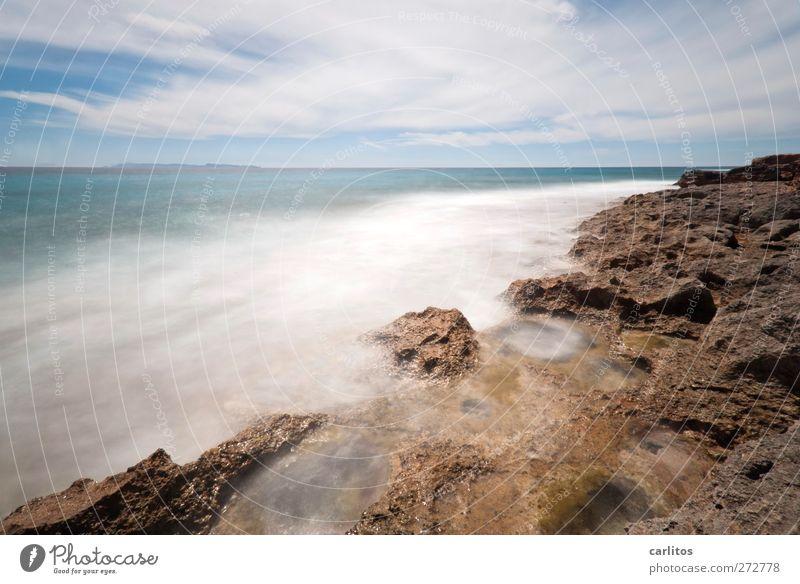 h two o Elements Air Sky Horizon Wind Rock Waves Coast Ocean Mediterranean sea Island Majorca Movement Esthetic Blue Brown Turquoise White Energy Environment