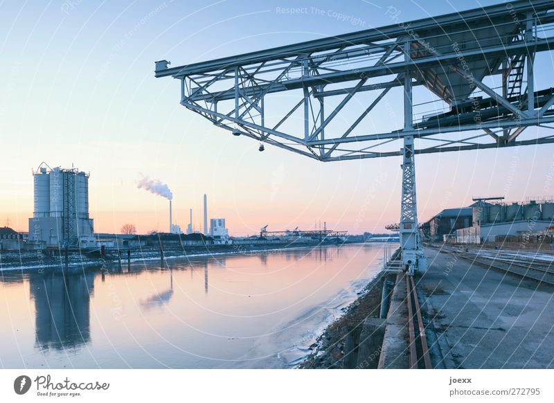 stepping stone Energy industry Coal power station Water Sky Cloudless sky Winter Beautiful weather Ice Frost Industrial plant Harbour Blue Yellow Orange Black