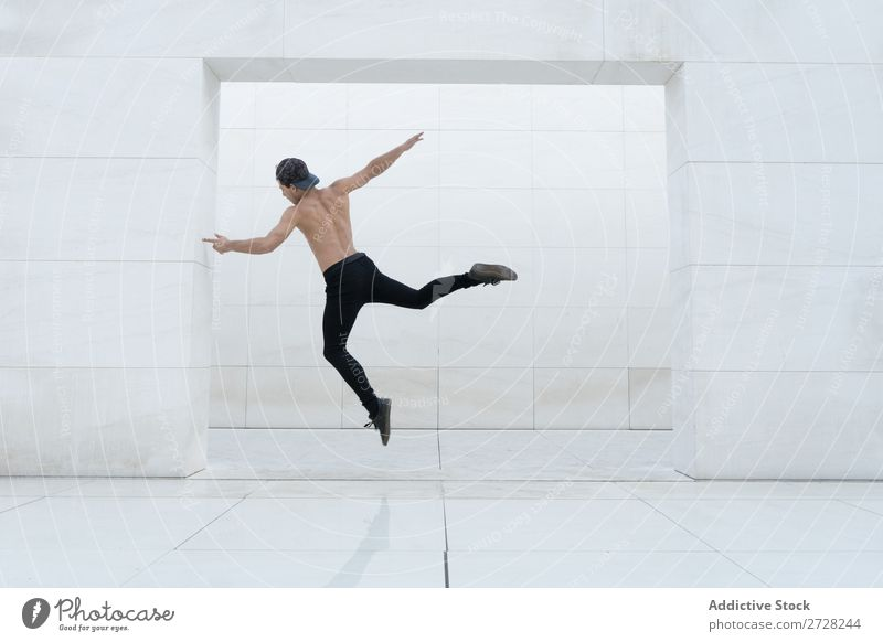 Shirtless man in jump Man Jump Studio shot Sports Modern Action Breakdance Dancer