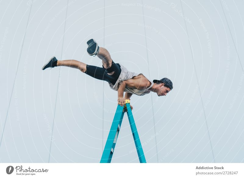 Man balancing on ladder Balance Handstand Acrobatic Athletic Sports Breakdance Posture