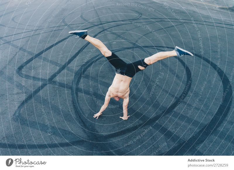Anonymous man dancing on pavement Man Dancer Balance Pavement Handstand Breakdance Acrobatic Athletic