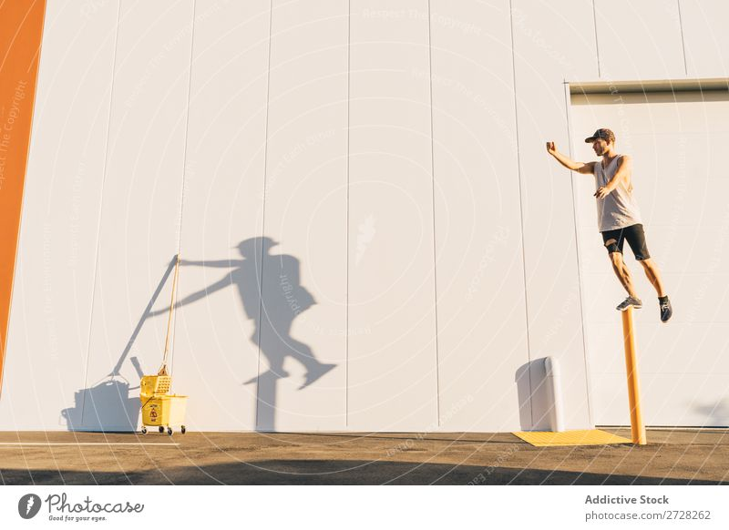 Dancer making creative shadow on wall Man Shadow Balance Creativity Conceptual design Acrobat Silhouette