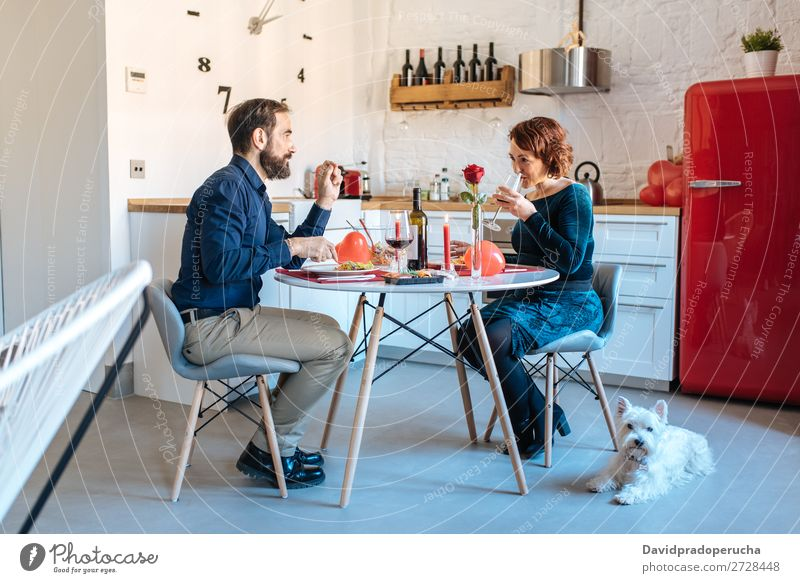 Mature couple having a romantic dinner at home for valentine's day Couple Relationship Affection Feasts & Celebrations Wife Surprise Husband Love
