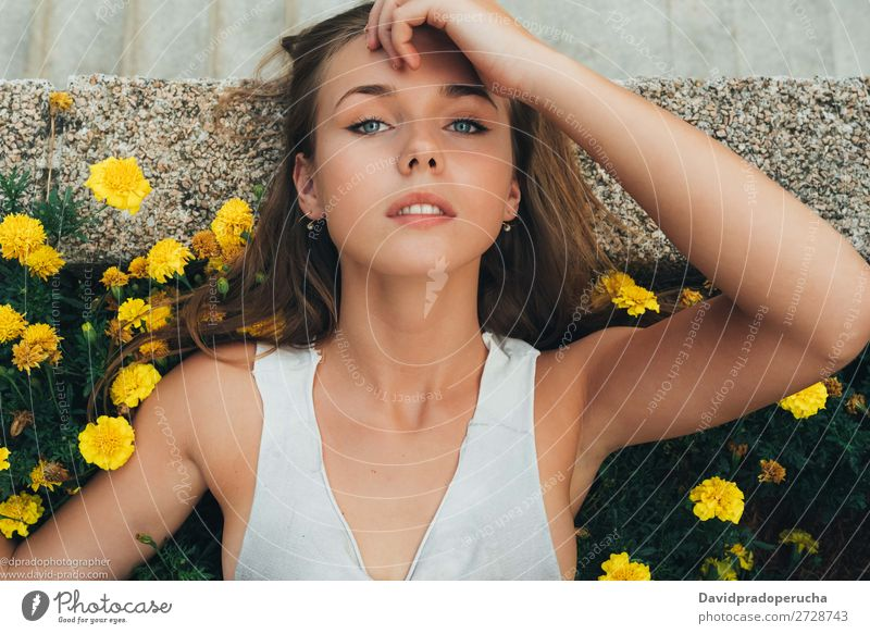 Young woman lying down on flowers Human being Feminine Youth (Young adults) Woman Adults Body Skin Face Eyes Nose Mouth Lips 1 18 - 30 years Self-confident Day