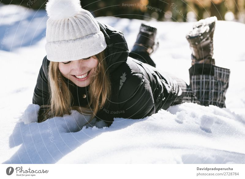 Young cute woman lying playing and enjoying snow in winter Winter Woman Snow Portrait photograph Youth (Young adults) Happy Playing Lie (Untruth) Blonde