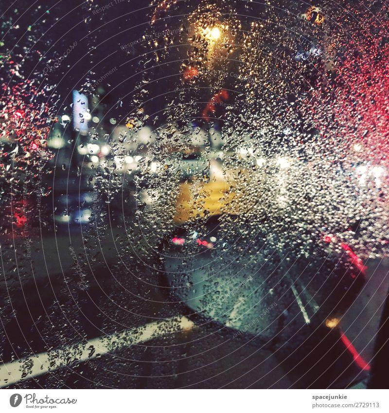Raining day. Water Drops of water Town Port City Deserted Illuminate Threat Dark Yellow Red Pane Car Mirror Street Lighting Bremen Driving Colour photo