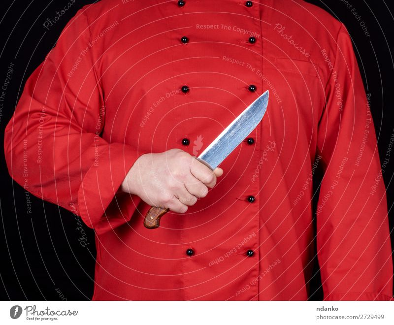 chef in red uniform holding a kitchen knife Knives Kitchen Restaurant Profession Cook Human being Man Adults Hand Steel Stand Red Black blade Caucasian chopping
