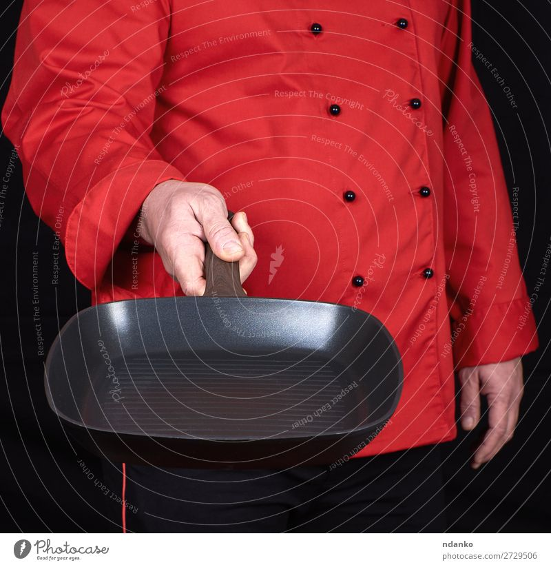 cook holding an empty square black frying pan Pot Pan Kitchen Restaurant Profession Cook Human being Man Adults Hand Clothing Metal New Red Black Cast iron