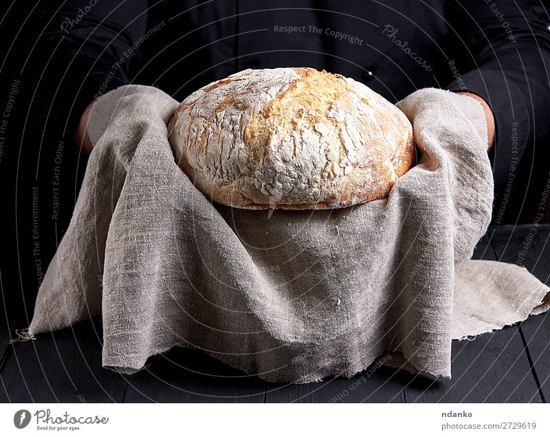 baked round homemade bread Bread Nutrition Table Kitchen Human being Hand Wood Eating Make Dark Fresh Brown Black White Tradition Baked goods Baking Baker