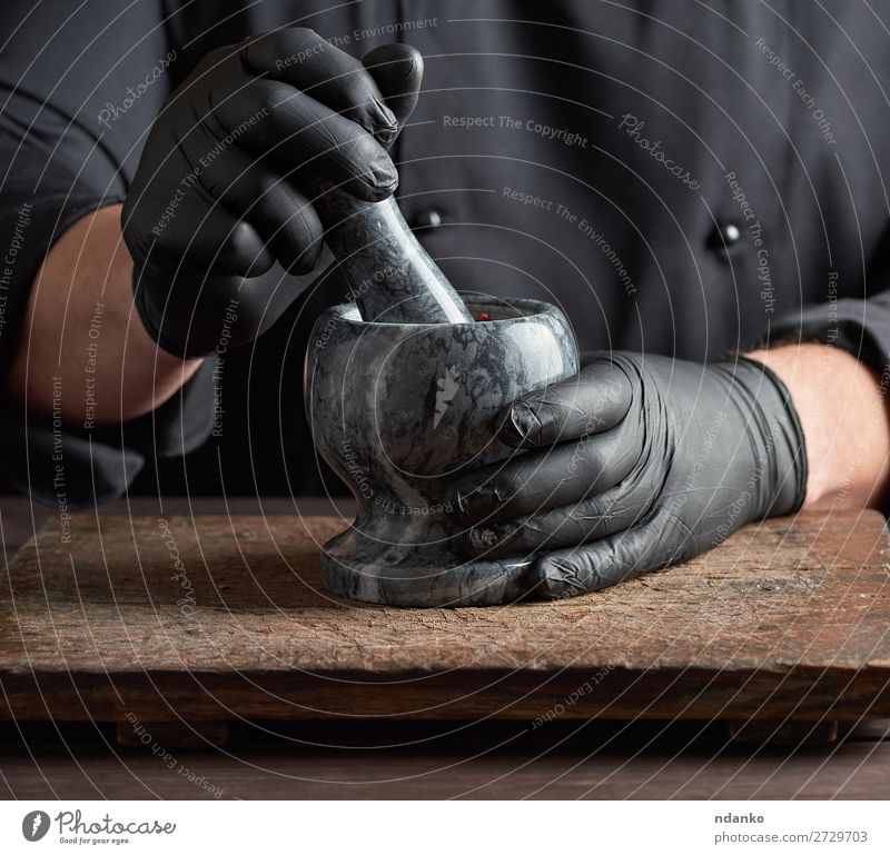 Chef in black latex gloves Herbs and spices Table Kitchen Work and employment Cook Tool Human being Man Adults Hand Gloves Stone Wood Make Dark Gray Black White