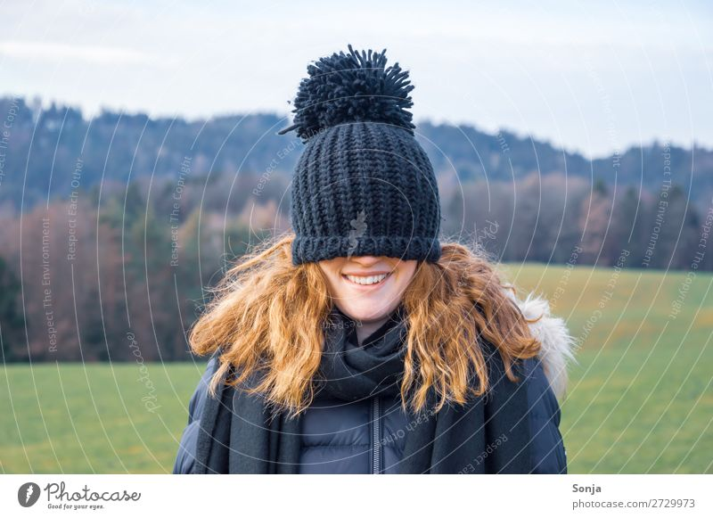 Young woman with a blue cap over her face Lifestyle Joy Leisure and hobbies Winter Hiking Feminine Youth (Young adults) Face 1 Human being 18 - 30 years Adults