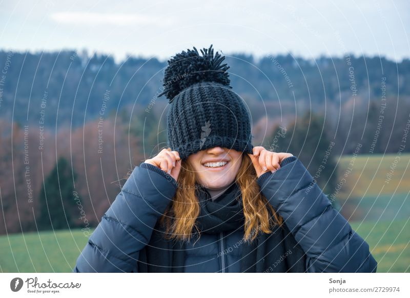 Young girl with a blue cap over her face Lifestyle Joy Happy Trip Winter Hiking Feminine Young woman Youth (Young adults) Face 1 Human being 18 - 30 years