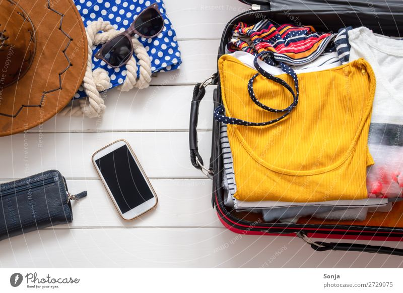 Packed suitcase for the beach holiday Lifestyle Vacation & Travel Tourism Adventure Far-off places Summer Summer vacation Sun Beach Ocean Cellphone