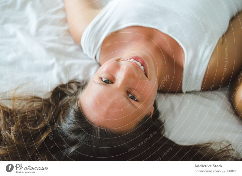 Smiling pretty woman on bed Woman Youth (Young adults) Beautiful Cheerful Happy Adults Attractive Looking into the camera Lie (Untruth) Bed Bedroom Home