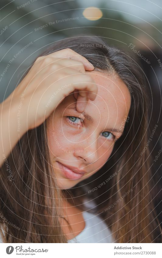 Pretty woman adjusting hair Woman pretty Youth (Young adults) Beautiful Hair Adjust Looking into the camera Beauty Photography Glass Window green eyes Brunette
