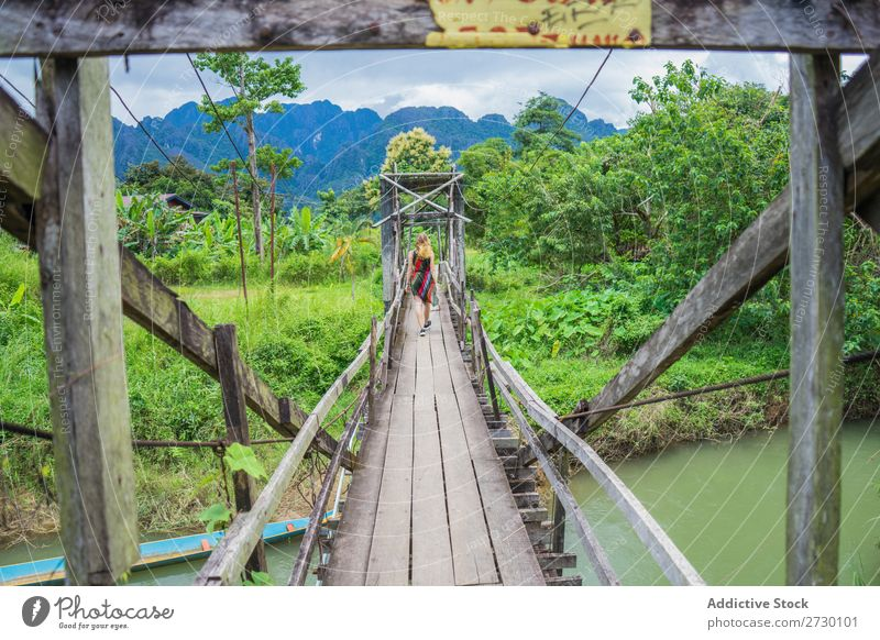 Woman walking in wooden bridge Virgin forest Bridge Wood Hanging Landscape Nature Vacation & Travel Forest Tropical Mystery Footbridge Footpath romantic