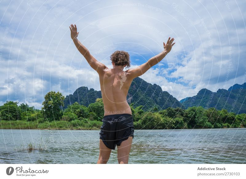 Man posing in tropics Virgin forest Mountain Freedom Posture Nature Landscape Adventure River Summer Vacation & Travel Environment tranquil enjoyment Hands up!