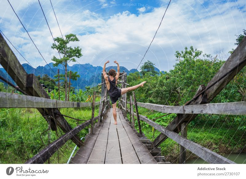 Man meditating on bridge Handstand Bridge Virgin forest Performance Exotic Sports Action