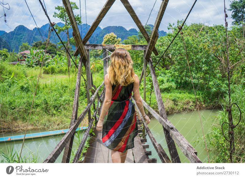 Woman walking on bridge Virgin forest Bridge Wood Hanging Landscape Nature Vacation & Travel Forest Tropical Mystery Footbridge Footpath romantic Construction