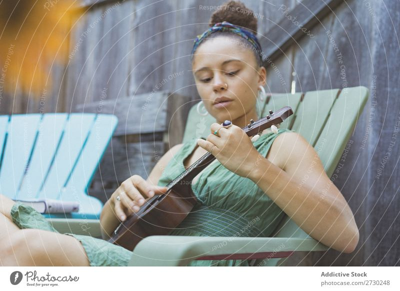 Girl playing ukulele in garden chair Woman Ukulele Musician Garden Relaxation Summer Guitar instrument Beautiful Youth (Young adults) Artist Lifestyle