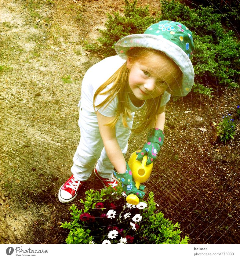 small gardener Feminine Child Girl Infancy Body Face 1 Human being 3 - 8 years Nature Summer Beautiful weather Flower Blossom Garden Gloves Hat Red-haired