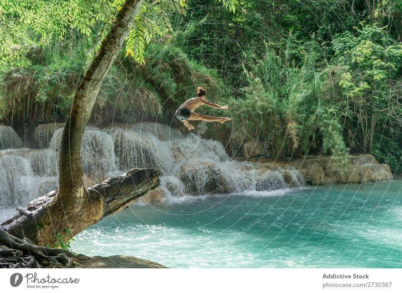 Man jumping to turquoise water Acrobat Nature Extreme Acrobatic shirtless Jump Story mid-air Water Lake Blue Healthy Lifestyle Sports Posture Adventure Strong