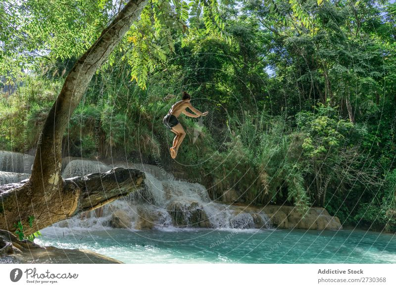 Man jumping to turquoise water Acrobat Nature Extreme Acrobatic Jump Story
