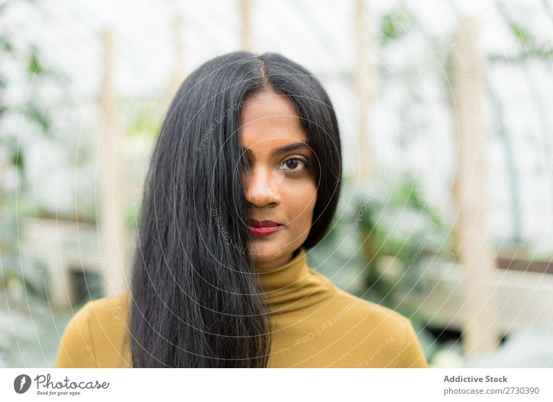 Pretty Indian ethnic woman in greenhouse Woman pretty Greenhouse Nature Style Looking into the camera Ethnic Plant Gardener Beautiful Youth (Young adults)