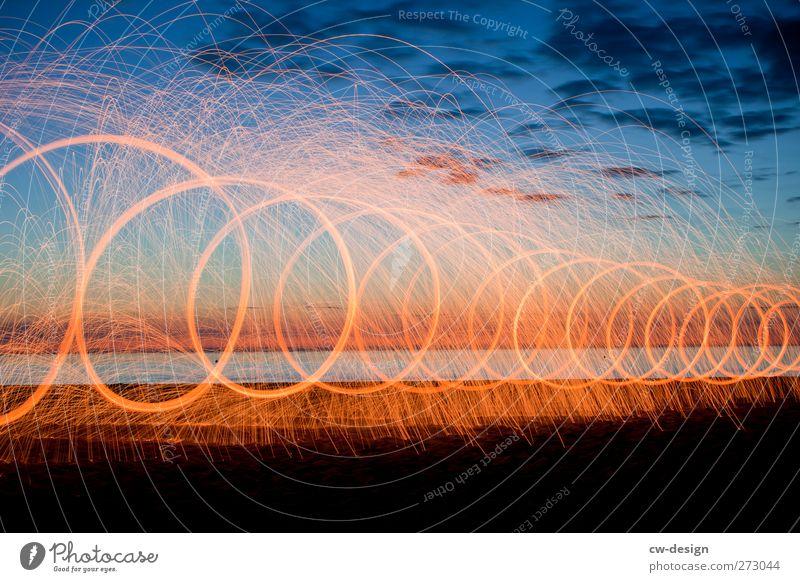 sea of light Adventure Summer New Year's Eve Event Shows Landscape Clouds Night sky Beautiful weather Coast Lakeside Beach Ocean Island Blue Orange Black