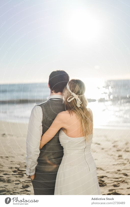 Bridal couple embraced on the beach Couple bridal Beach tender in love Wedding Expression romantic Feasts & Celebrations Style Relationship Love Engagement